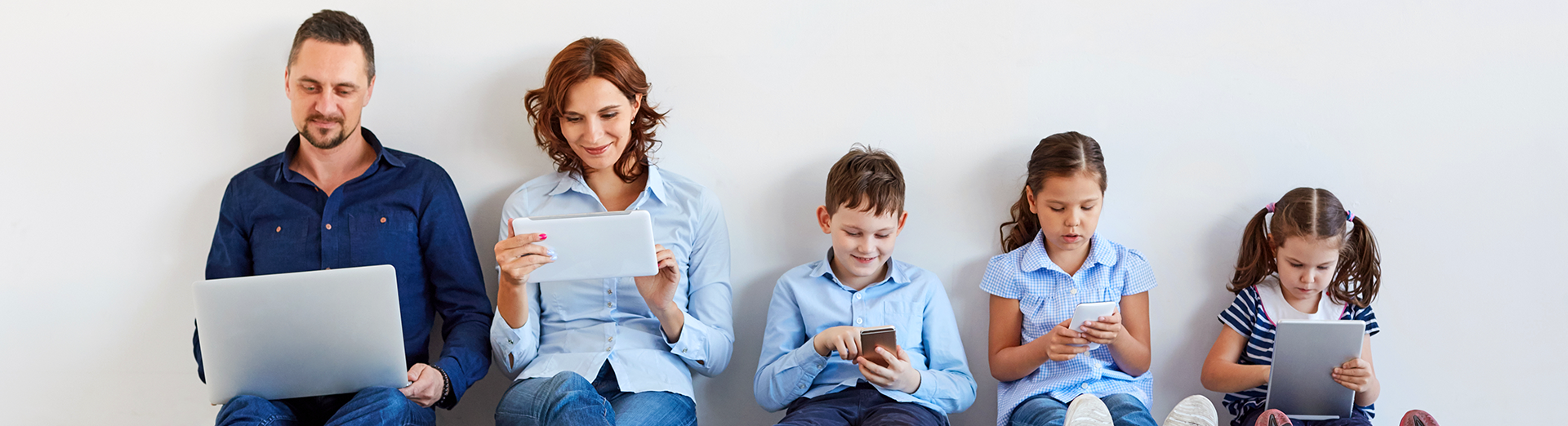 Family_using_devices_at_home